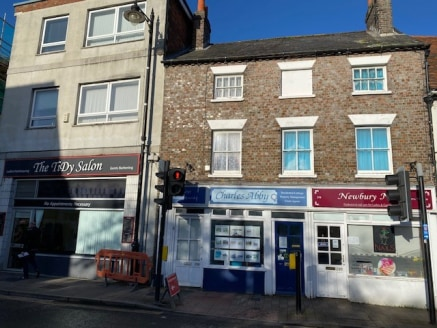 The property comprises a retail unit fronting Bartholomew Street. Internally the property comprises concrete floor covered with carpet, painted walls, painted ceiling with spotlighting, display window and entrance door. The property is heated and coo...