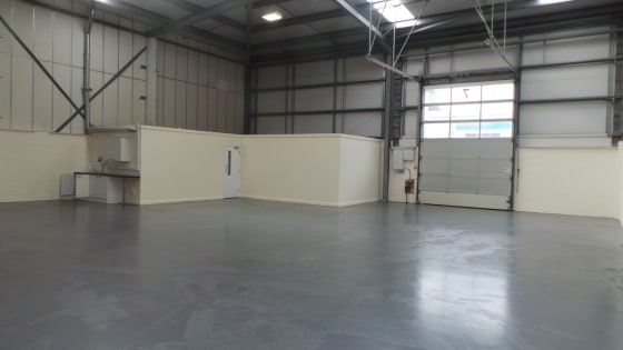 This end-terraced industrial unit of steel portal framed construction provides a little under 3,000 sq ft of accommodation. There is a minimum eaves height of 20ft 4'', rising to a maximum of 24ft 1'' at the apex. The premises were constructed in the...