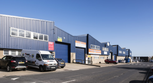 2 miles East of Newcastle City Centre. High profile onto Fossway. Clear height of 5m. Steel roller shutter loading door. Internal office, W.C. and amenity area. Parking to the front.