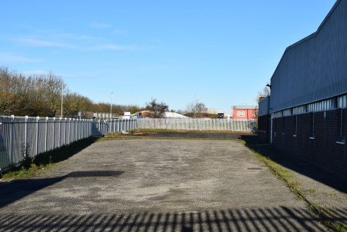 TO LET / FOR SALE - DETACHED INDUSTRIAL PREMISES.  The property comprises an open plan steel portal framed industrial unit with brick walls to dado level and cladding to the elevations. To either side of the main warehouse area there are two annexes...