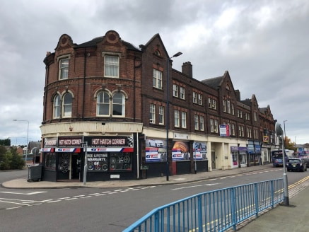 A substantial three storey building which is made up of ground floor retail units, which are currently let out and income producing.