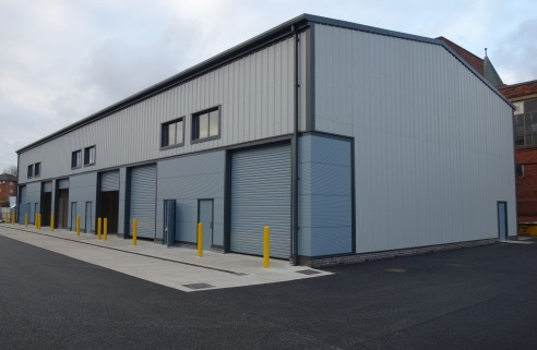 The scheme comprises of seven new warehouse / workshop units, with an eaves height of 7.5 metres. Clad in attractive profile sheeting for the walls and roof.  The units are a steel portal frame construction, with a concrete floor and have car parking...