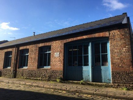 INDUSTRIAL UNIT  DOUBLE ROLLER SHUTTER  CENTRE OF MACCLESFIELD  DESCRIPTION  The property is a former motorbike repair unit situated in Macclesfield. There is a double roller shutter door, with two side by side units. The property has parking to the...