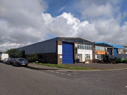 The unit is a prominent corner positioned industrial premises of steel portal frame construction with brick block and part steel cladding offering factory with WC, reception and offices over ground and first floor measuring approximately 3,371 sq ft....