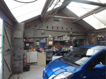 TWO BAY WORKSHOP CURRENTLY USED FOR CAR REPAIRS AND A SPRAY BOOTH. POTENTIAL FOR REDEVELOPMENT...