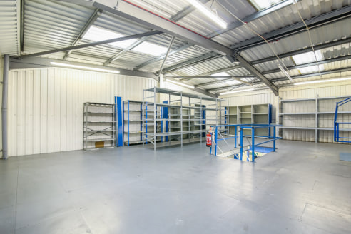 The property comprises a light industrial warehouse building of steel portal frame construction with brick block work and steel profiled cladding above. The ground floor warehouse is currently vacant and available on a short term let. The warehouse i...