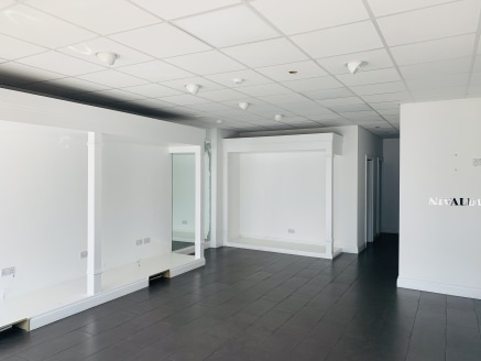 A ground floor lock-up shop unit forming part of a small retail parade. The unit measure at 801 sq ft and has a net internal width of 20ft and a built depth of 42ft. The shop has a modern interior fit-out with tiled floors, suspended ceilings with LE...