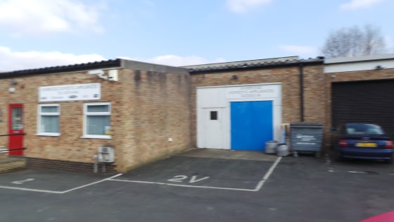 This mid-terrace unit of concrete portal frame construction benefits from a concrete floor, steel roller shutter door and an eaves height of 11ft, rising to an apex of 12ft 7in. There are WC and staff facilities and externally there is an area of con...