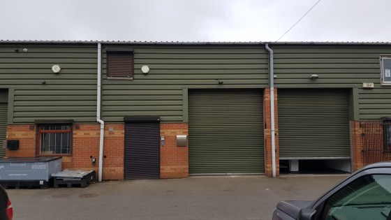 Description  Unit 2 comprises a modern mid-terrace industrial unit of portal-steel frame construction with cavity brick and insulated sheet clad elevations under an insulated sheet clad roof. The unit has a full-size loading door to the front elevati...