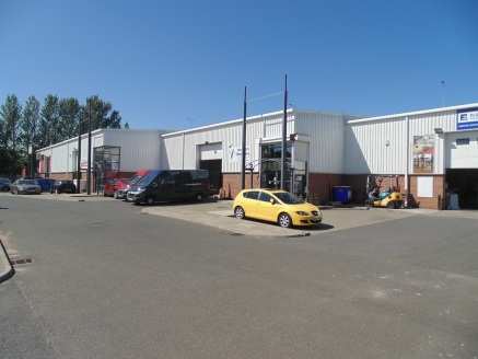 Modern Trade Park Units on Popular Estate. Highly Visible from A695 Chainbridge Road. Eaves Height 6m. Up and Over Sectional Loading Door.