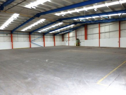 "Recently refurbished detached workshop/warehouse unit incorporating integral offices, staff and WC facilities.<br><br>Vehicular access is via 2 no. roller shutter doors. The unit has a clear eaves height of 5m(16'5""). Externally the unit has a good s..."