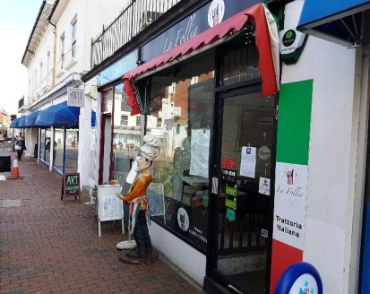 "A small restaurant premises situated in a busy retail parade, comprising an open plan front seating area, with 22 covers, and an ""open"" kitchen beyond.\n\nThere is a side corridor serving a rear WC.\n\nThe current license allows opening times between..."