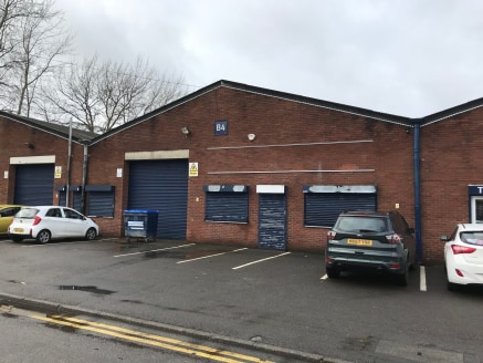 The estate comprises 11 industrial / trade counter units in two terraces. The units are of steel portal frame construction, with traditional brick block elevations.   The unit comprises a mainly open plan warehouse, with two small offices to the grou...