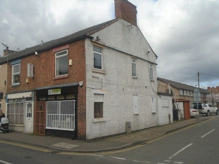 The subject property comprises a two storey end terrace mixed use building with the ground floor comprising of a lock up shop providing an open plan retail area which presents relatively well and consists of painted plaster walls, laminate floor cove...