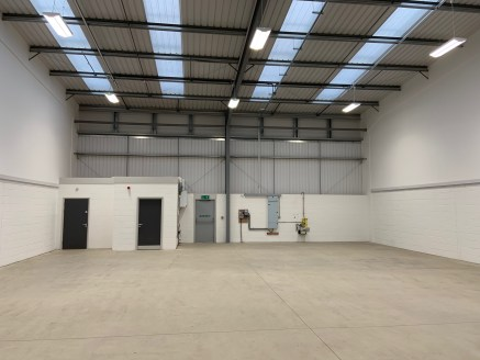 Brand new industrial unit. Electrically operated sectional up and over loading door. Minimum eaves height 5m. Average of 80,000 vehicles passing daily. Warehouse/production area lighting. Site monitored by CCTV.