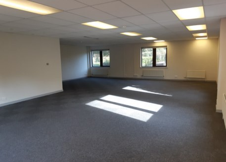 The property comprises ground and first floors of an end of terrace office building, with parking to the front and rear. The property is accessed via it's own dedicated front door leading to a ground floor lobby, and in turn WC's, ground floor open p...