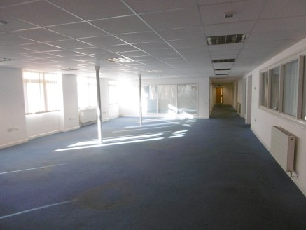 The modern offices are of single storey brick and flat roof construction and provide a range of well fitted offices with extensive onsite facility. A range of open plan and partitioned offices are provided being carpeted, gas centrally heated, fitted...