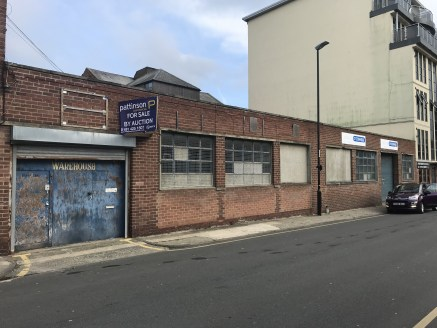 Briefly the property comprises of a brick 1960's unit arranged over two floors with a flat roof.   Internally the ground floor warehouse/workshop space benefits from fluorescent tube lighting, concrete flooring, gas blow heater and small partitioned...