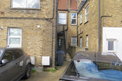 * Entire property currently consisting of ground floor retail with a self contained maisonette above.  * Two ground floor shops   * 2 bedroom flat above  * Rear parking space  * Potential to add value by improving the residential income, undertake de...