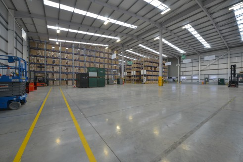 10m clear height to underside of haunch. 2 level access loading doors and 2 dock level loading doors to one elevation, 2 level access loading doors and 1 dock level loading door to the other elevation. Loading canopy. 50kN per sq m floor loading. 10%...