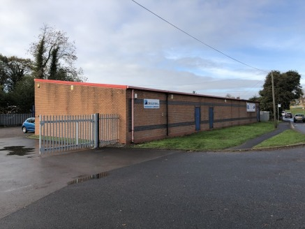 A mid-terraced single storey industrial unit standing within a secure yard with shared parking available. The unit benefits from a secure roller shutter to the front with pedestrian access via a separate door. The unit is considered suitable for eith...