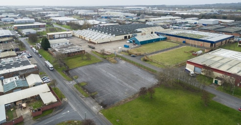 The property comprises a substantial industrial facility with extensive yard and parking areas, and adjoining offices. To the rear there is a further area of compound and/or development land. The building has been subdivided to provide a number of in...