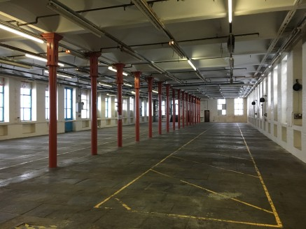 The property briefly comprises upper floor good quality mill accommodation suitable for industrial storage/production space benefiting from;  Ground floor loading and goods service lift;  Suspended stone flagged floor;  Fluorescent strip lighting;  O...