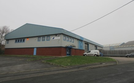 The premises is a modern industrial building of steel portal frame construction with concrete floor, elevations of blockwork and cladding above. The pitched roof incorporates roof lights and access is via two steel roller shutter doors in the side el...