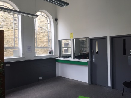 **1/3 Rates discount may be applicable on retail premises as of April 2019, subject to qualification**  The premises briefly comprise a stone built former library located in the centre of the busy King Cross Rd on the outskirts of Halifax.  The unit...