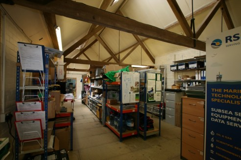 Attractive building providing storage or light workshop space in an established complex