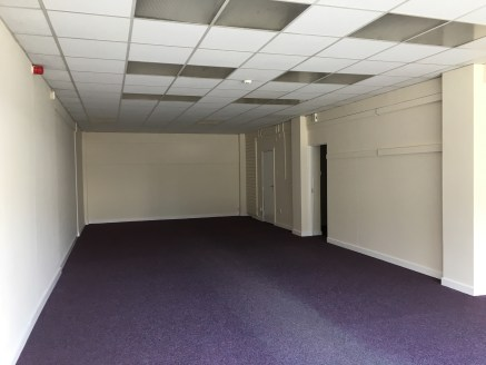 Realtex House is a mixed use building offering a range of retail and office space.  The subject unit comprises a ground floor lock-up retail unit with frontage to Leeds Road.  The retail area has a painted plaster finish to the walls, suspended ceili...
