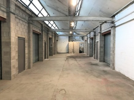 A series of self-contained workshop/storage units positioned close to junction 10 of the M65 motorway.\n\nThe lockup units are of blockwork construction with an open plan layout with good natural light, concrete floors and are suitable for various us...