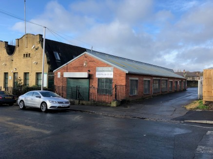 The property comprises a single storey brick built light industrial unit under a pitched profile sheet covered roof supported by steel truss frames.   The unit benefits from a solid concrete floor throughout and is currently configured to provide an...