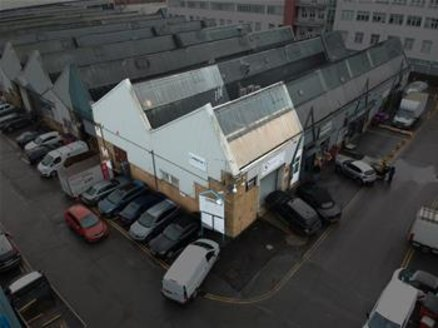 The subject premises comprise a prominently located, end of terrace, 1960's built steel truss frame industrial building to a pitched roof. The warehouse area is of an open-plan layout, situated over the ground floor and ancillary office accommodation...