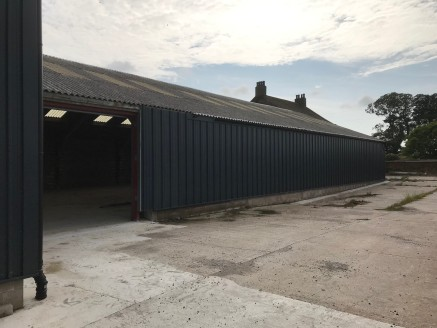 The property comprises a steel framed industrial unit which has been clad in profile metal cladding. The property benefits from a solid concrete floor, metal roller goods shutter, three phase electric, 6m eaves height rising to 9m at the apex. WC fac...