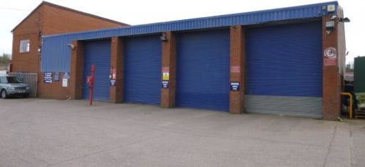 The premises comprise a commercial vehicle repair workshop with ancillary offices/toilets.\n\nThe workshop is of steel portal framed construction with brick/insulated profiled sheeted walls surmounted by a pitched, insulated roof. Height to underside...