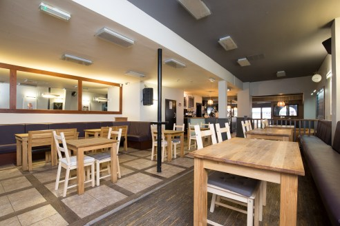 Prominent town centre café bar/restaurant premises consisting of a spacious trading area benefiting from an opening frontage onto the high street, attractive bar/servery, dining area (approximately 60 covers) and toilets at ground floor level. On the...