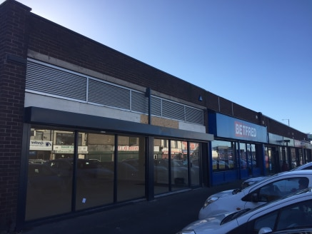 The unit is located in the busy Fingerpost Shopping Centre fronting Higher Parr Street on the outskirts of St Helens town Centre. Other occupiers in the scheme include Betfred, Booze Buster, Ian James Chemist, Chipmunk Take Away and  Fingerpost News...