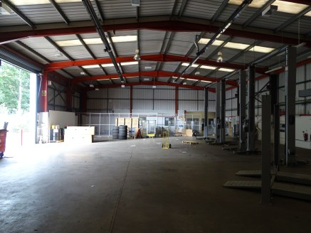 The unit is a detached steel framed building with brick and blockworks walls, predominantly clad in modern profiled metal sheeting, under a metal profile sheet roof incorporating translucent panels. The unit comprises mainly a storage/workshop area,...