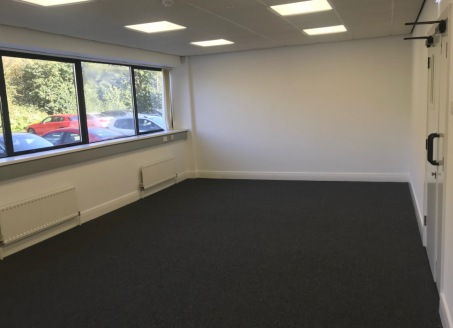 Unit A is an 'L' shaped office building on ground and first floor levels. Suspended ceilings, electric strip lighting, solid floor with perimeter trunking, category 5 cabling, carpeting, passenger lifts and gas central heating, 24hr manned security a...