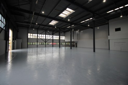 Concrete floor. 8.08 - 8.40m eaves. Fluorescent Strip Lighting, 10% translucent panels. Gas air blowers. Up and over electric loading doors. The office specification includes;  Mixture of open plan and partitioned offices. Carpeted floors, Suspended...