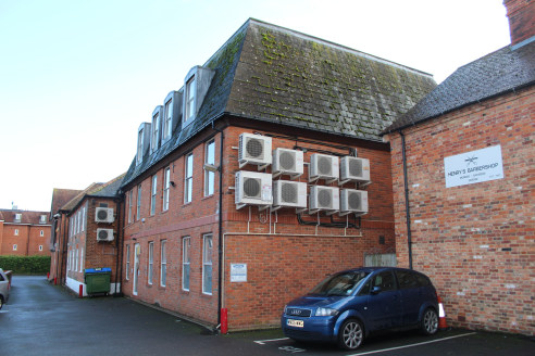 1 The Pentangle comprises a self contained office building, constructed in the mid 1980's. The property is constructed over ground, first and second floors. The building is of brick construction with a pitched mansard style roof with slate covering....