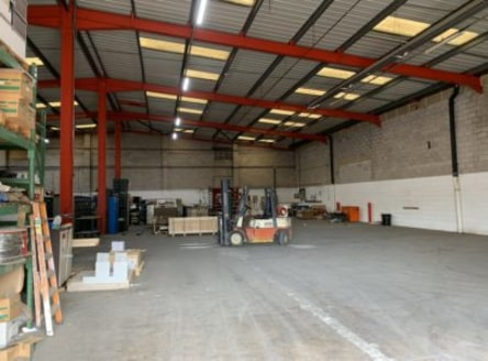 The property comprises a steel portal framed workshop with brick and block lower walls with profile steel cladding above, and concrete floor.<br><br>There is an electronically operated up and over door to the front elevation providing vehicular acces...