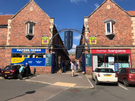 The unit is located centrally within The Arcade and is arranged over ground and first floor levels. The ground floor comprises an open plan sales area with rear w/c. The first floor has a number of rooms and would be suitable for office/ancillary use...