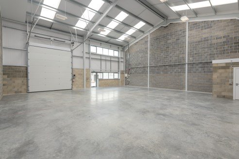 DESCRIPTION:\n\nUnit 4 is an attractive mid terrace industrial/warehouse unit of steel portal frame construction with block/metal clad elevations under an insulated roof. The property benefits from three phase power, high bay lighting an electronic a...