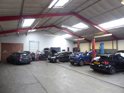 The property consists of a ground floor light industrial unit of steel portal frame and block and profile clad elevations beneath a pitched steel profile roof. Internally the unit is currently fitted out as a vehicle repair workshop and is largely op...