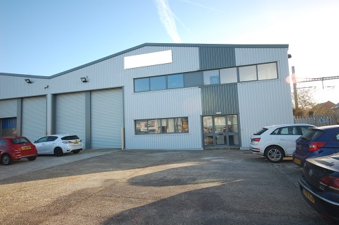 10,146 sq ft\n\nWarehouse / Workshop\n\n* 6 metre minimum eaves\n\n* 2 motorised roller shutter doors each 10ft 6ins wide x 16ft 3in high\n\n* Painted concrete floor\n\n* Translucent roof panels\n\n* Fluorescent lighting\n\n* 2 overhead gas blower he...
