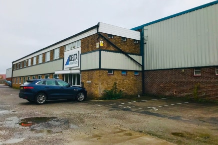 The property comprises a self-contained warehouse which forms part of a larger premises, with adjoining occupiers being located to the left and rear. The property itself is of portal steel frame construction with block elevations to the lower part an...