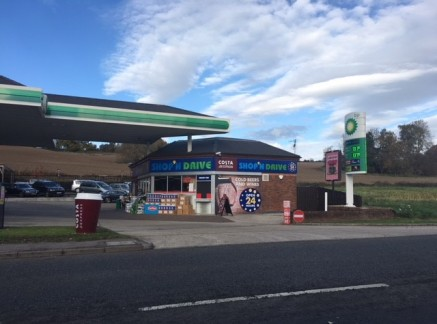 The property comprises a prominent Petrol Station with Forecourt sales, shop, car wash and separate workshop buildings.   The Petrol Station and workshop sit on a site of 2.65 acres.  Both elements of the site are currently let, the Petrol Station wi...