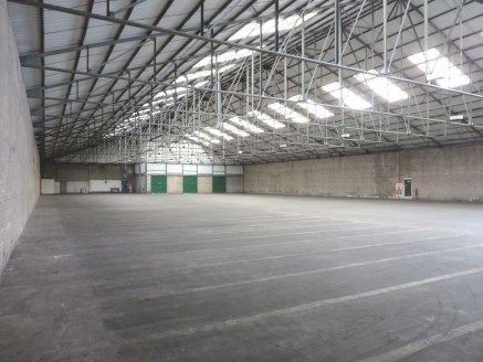 Semi-detached industrial warehouse facility with covered loading bay and level loading facilities at both ends of building.<br><br>Eaves 5.4m<br><br>Offices and ancillary facilities provided.<br><br>New FRI lease on terms to be agreed.<br><br>Terms:...